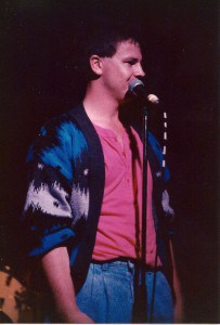Cardigan and pink tee onstage